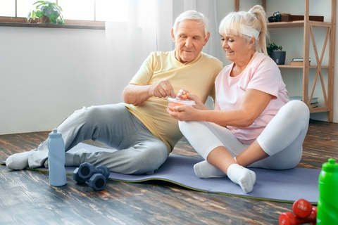 senior couple exercising and eating healthy