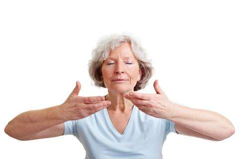 senior woman practicing breathing
