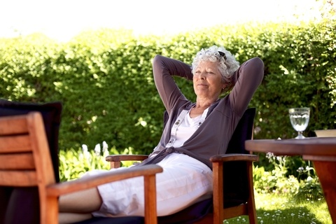 senior woman relaxing outside