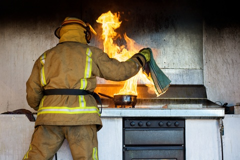 fireman putting out a stove fire