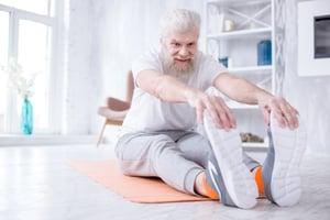 elderly man stretching