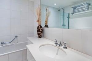bathroom with hand rail