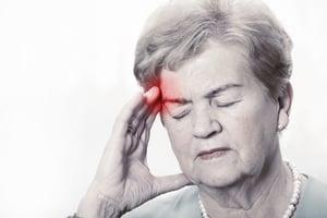 elderly woman with headache