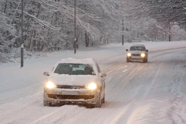 cars driving in deep snow