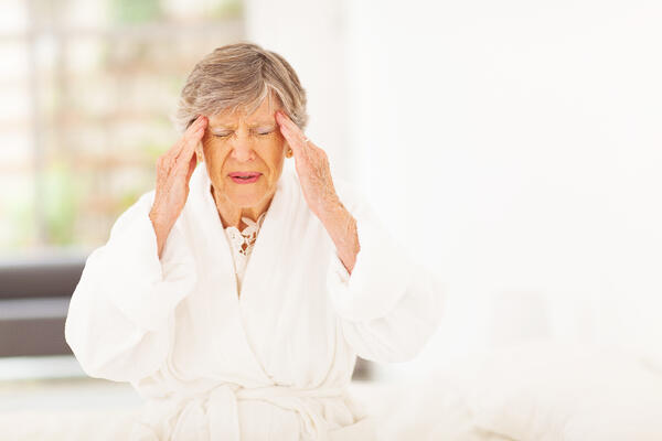 older woman with a headache