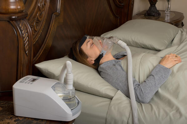 woman using a CPAP machine