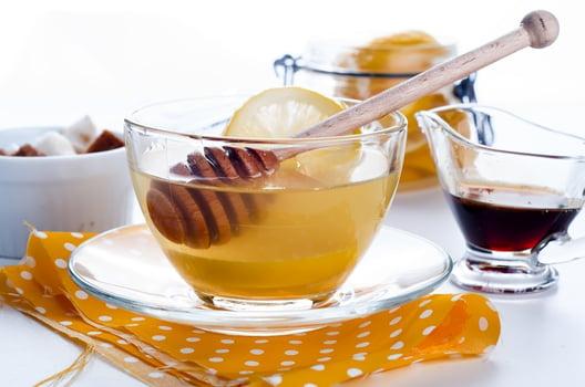 honey and lemon in warm tea