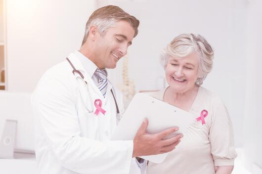 doctor discussing breast cancer with a patient