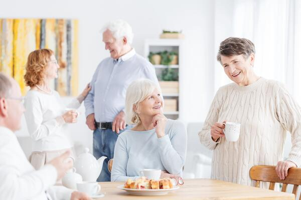 a group of people talking in a support group for copd