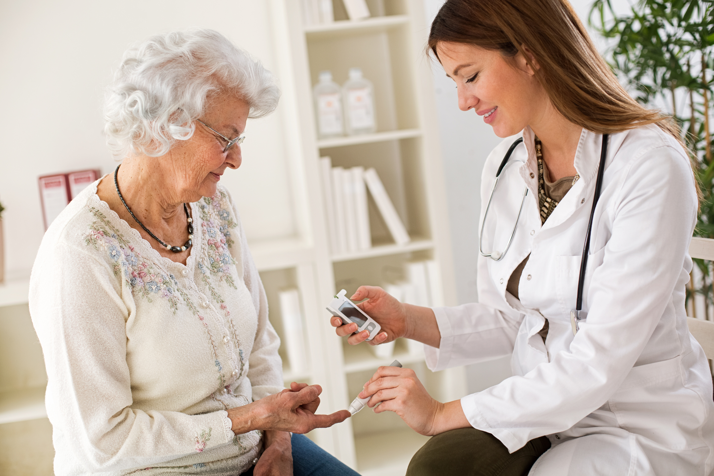 doctor blood testing a diabetes patient